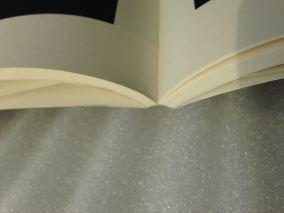 Modern single page glued binding.